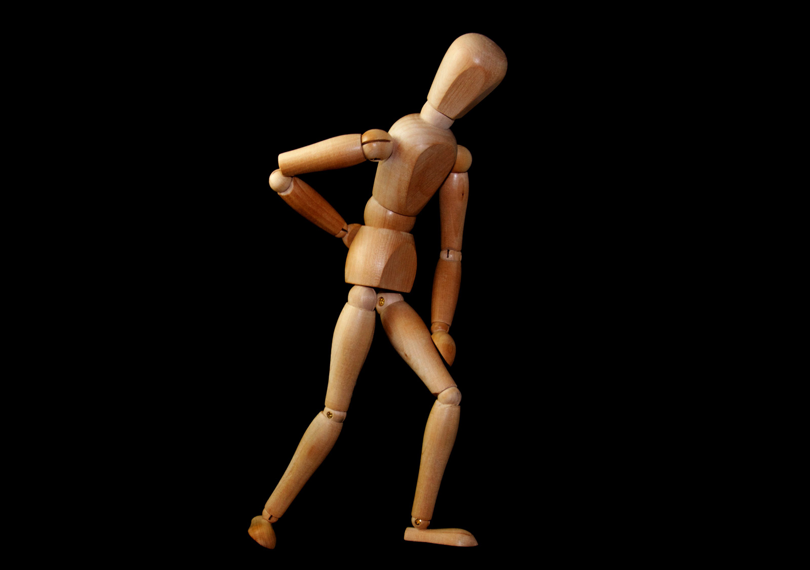 Wooden Figure demonstrating lower back pain risk assess manual handling training mechanical aids plan